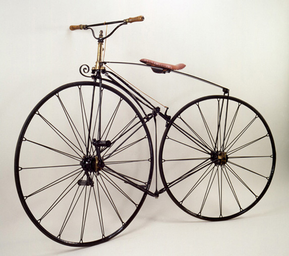 Phantom Velocipede, ca. 1869<br> Reynolds & Mays, London<br> England<p>  The first English velocipede with a suspension wheel and solid rubber tires. This machine features a central articulating hinge.