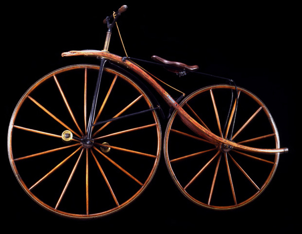 Velocipede, ca. 1870<br> George C. Miller, Chicago<br> United States<p> 	 The ornate front extension with the carved eagle's head and the wood frame that sweeps beyond the rear wheel are unique embellishments.